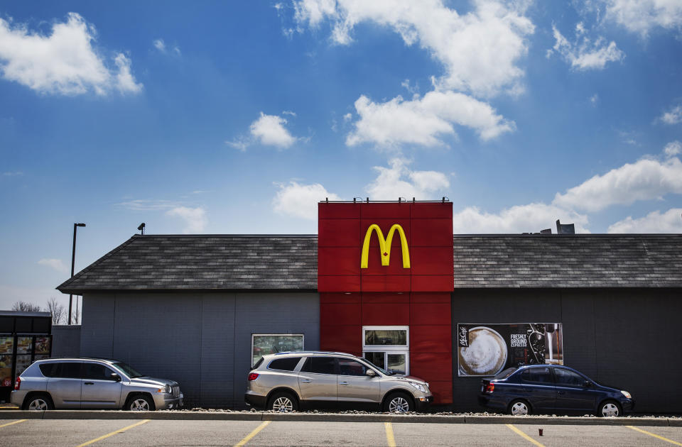 Cars line up in a drive through lane at a McDonalds fast food restaurant in Toronto, May 1, 2014.  About 400,000 people came to Canada under the government's temporary foreign worker program, which is designed to fill jobs for which there are no qualified Canadian candidates. The program has been hugely popular with employers, ballooning from 100,000 workers in 2002. But the backlash against it has also grown as the program, initially designed to help the booming resource industry, has expanded to lower-skilled jobs, especially at restaurant chains such as McDonald's Corp and Tim Hortons Inc. To match Feature CANADA-EMPLOYMENT/TEMPORARY   REUTERS/Mark Blinch (CANADA - Tags: BUSINESS EMPLOYMENT FOOD POLITICS)
