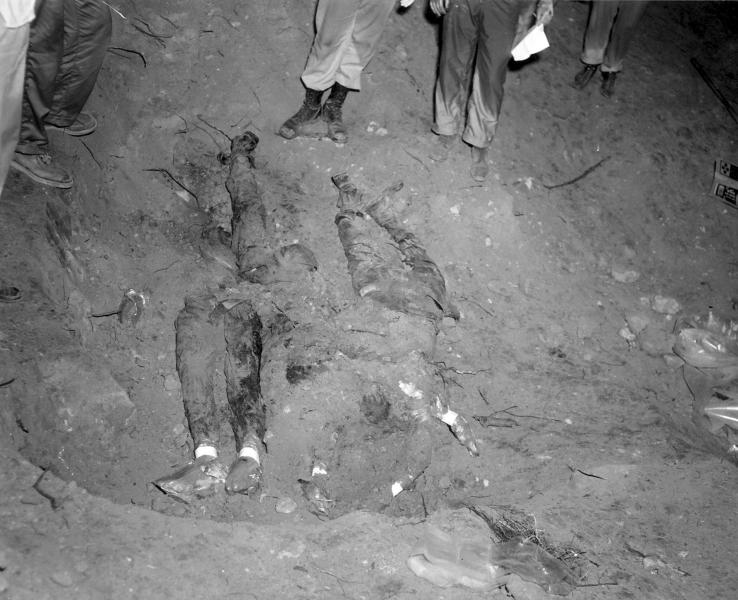 FILE-In this 1964 file photo released by the FBI, the bodies of three civil rights workers are uncovered from an earthen dam southwest of Philadelphia, Miss. The photograph was entered as evidence by the prosecution in the trial of Edgar Ray Killen, who was convicted in 2005 for three counts of manslaughter in the deaths of James Chaney, Andrew Goodman and Michael Schwerner. (AP Photo/FBI, File)