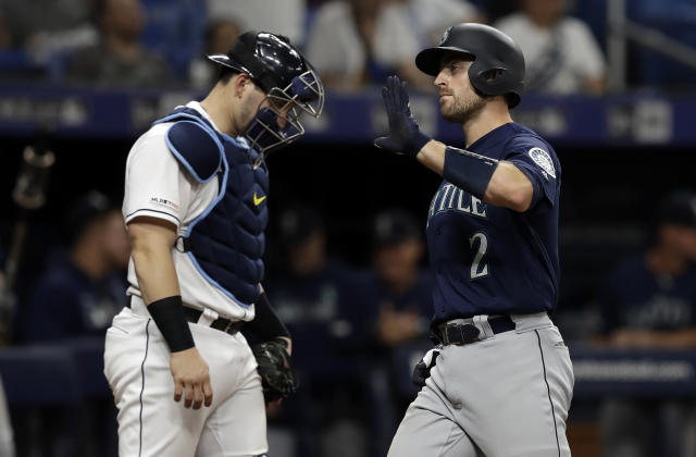 Seattle Mariners' Tom Murphy (2) celebrates his two-run home run off Tampa Bay Rays relief pitcher Jalen Beeks during the sixth inning of a baseball game Tuesday, Aug. 20, 2019, in St. Petersburg, Fla. Catching for the Rays is Mike Zunino. (AP Photo/Chris O'Meara)