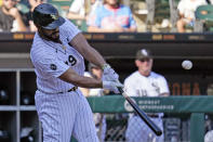 Chicago White Sox's Jose Abreu hits a sacrifice fly during the seventh inning of a baseball game against the Los Angeles Angels in Chicago, Thursday, Sept. 16, 2021. (AP Photo/Nam Y. Huh)