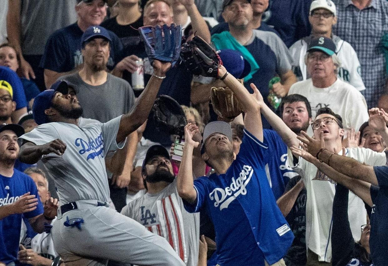 There was only one person in a Dodgers jersey that could have made an out here. (AP Photo)