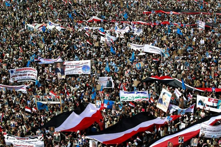 Yemenis protest against a Saudi-led coalition which supports various factions aligned with Yemen's internationally recognised government against Huthi rebels