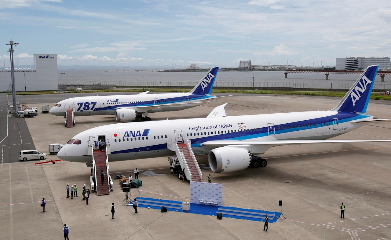 An All Nippon Airways' (ANA) Boeing 787-9 Dreamliner airplane (front) is parked next to a Boeing 787-8 Dreamliner before a ceremony to celebrate its first passenger flight for ANA at Haneda airport in Tokyo August 4, 2014.   REUTERS/Yuya Shino/File Photo