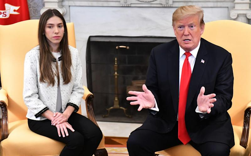 Donald Trump and Fabiana Rosales, wife ofVenezuelan opposition leader Juan Guaido, in the White House on Wednesday - UPI / Barcroft Media