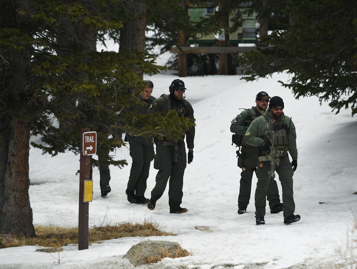 SWAT officers walk out of the woods near Echo Lake Campground in Arapaho National Forest after finding the body of Sol Pais on Wednesday. (Photo: RJ Sangosti/Denver Post)