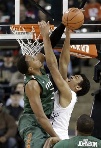 Wake Forest's Devin Thomas, right, has his shot blocked by Miami's Kenny Kadji, left, during the second half of an NCAA college basketball game in Winston-Salem, N.C., Saturday, Feb. 23, 2013. Wake Forest won 80-65. (AP Photo/Chuck Burton)