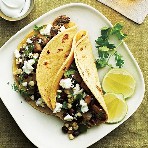 """<p>Keep your tortillas soft by wrapping them in foil and keeping them in a warm oven.</p> <p> <a rel=""""nofollow noopener"""" href=""""http://www.myrecipes.com/recipe/mushroom-corn-poblano-tacos"""" target=""""_blank"""" data-ylk=""""slk:View Recipe: Mushroom, Corn, and Poblano Tacos"""" class=""""link rapid-noclick-resp"""">View Recipe: Mushroom, Corn, and Poblano Tacos</a></p>"""