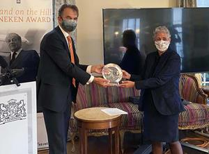 Ambassador André Haspels presents Michelle Browdy of IBM with the 2020 Holland on the Hill Heineken Award.