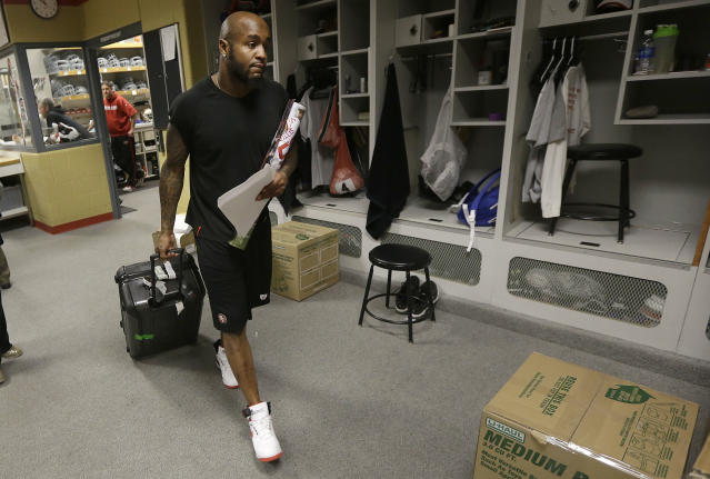 San Francisco 49ers safety Donte Whitner pulls a bag as he exits a locker room at an NFL training facility in Santa Clara, Calif., Monday, Jan. 20, 2014. The 49ers lost to the Seattle Seahawks in the NFC Championship Game. (AP Photo/Jeff Chiu)