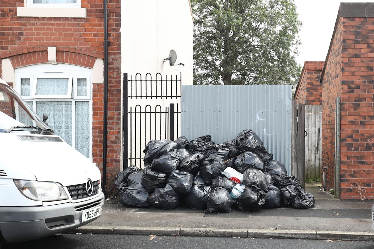 <p>The strikes have left piles of rubbish stacked up on streets in Birmingham [Picture: PA] </p>
