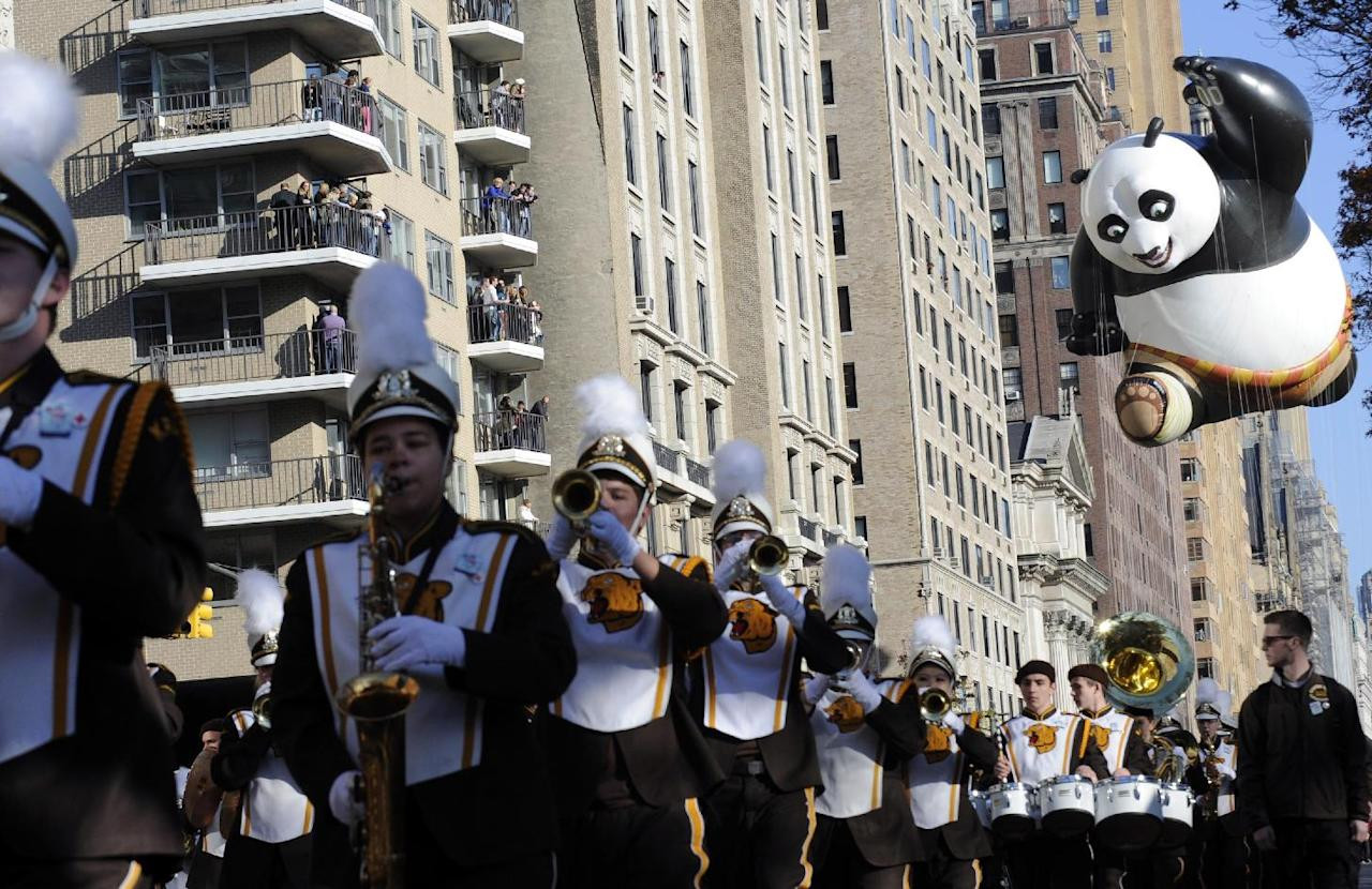 The Kung Fu Panda balloon, right, participates in the 86th annual Macy's Thanksgiving Day Parade,Thursday, Nov 22, 2012, in New York. (AP Photo/ Louis Lanzano)