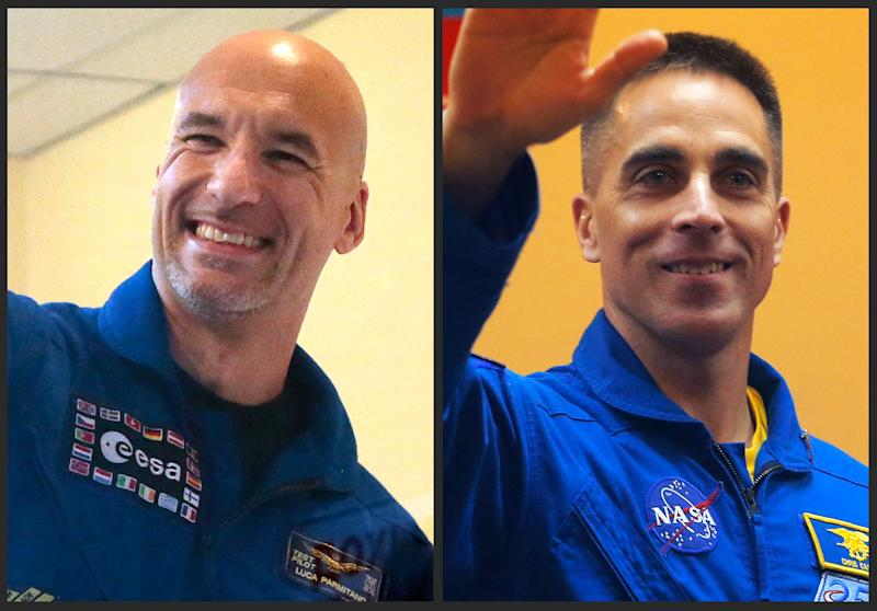 FILE - This combination of 2013 file photos shows European Space Agency astronaut Luca Parmitano of Italy, left, and U.S. astronaut Christopher Cassidy in the Baikonur cosmodrome in Kazakhstan. In one of the most harrowing spacewalks in decades, Parmitano had to rush back into the International Space Station on Tuesday, July 16, 2013 after a mysterious water leak inside his helmet robbed him of the ability to speak or hear and could have caused him to choke or even drown. His spacewalking partner, Cassidy, had to help him inside after NASA quickly aborted the spacewalk. (AP Photo/Mikhail Metzel, Dmitry Lovetsky)