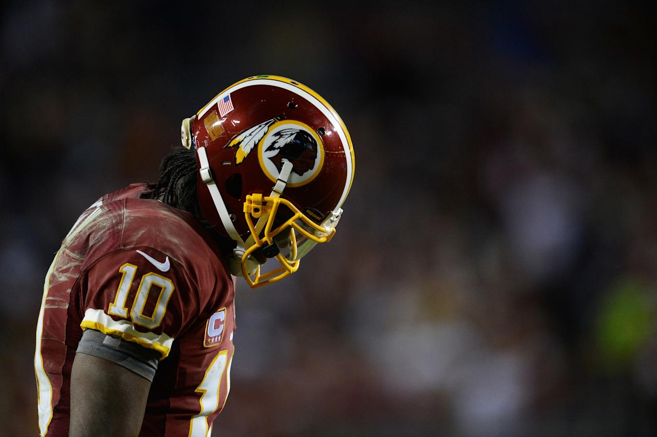 LANDOVER, MD - JANUARY 06:  Robert Griffin III #10 of the Washington Redskins reacts during their NFC Wild Card Playoff Game against the Seattle Seahawks at FedExField on January 6, 2013 in Landover, Maryland.  (Photo by Patrick McDermott/Getty Images)