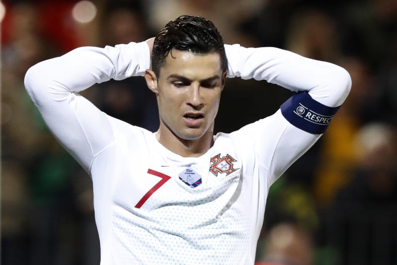 Portugal's Cristiano Ronaldo, reacts during the Euro 2020 group B qualifying soccer match between Lithuania and Portugal at LFF stadium in Vilnius, Lithuania, Tuesday, Sept. 10, 2019. (AP Photo/Mindaugas Kulbis)