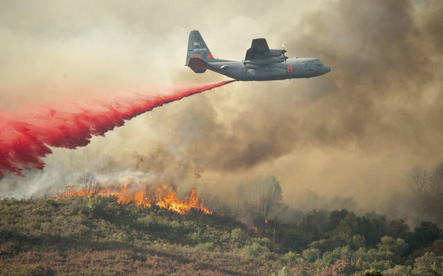 <p>A U.S. Air Force plane drops fire retardant on a burning hillside in the Ranch Fire in Clearlake Oaks, Calif., on Aug. 5, 2018. (Photo: Josh Edelson/AP) </p>