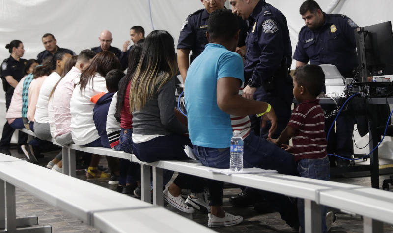 Migrants who are applying for asylum in the United States go through a processing area at a new tent courtroom at the Migration Protection Protocols Immigration Hearing Facility, in Laredo, Texas. More immigration judges are overseeing hearings remotely in secretive tent courts the U.S. government has built along the southern border. (Photo: Eric Gay/AP)