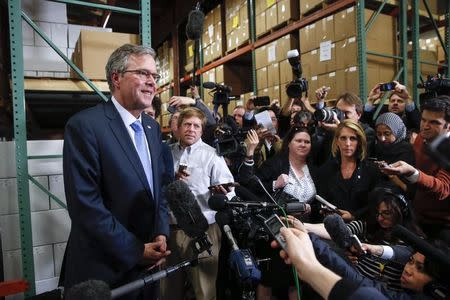 Former Florida Governor Jeb Bush speaks to the media after visiting Integra Biosciences during a campaign stop in Hudson, New Hampshire