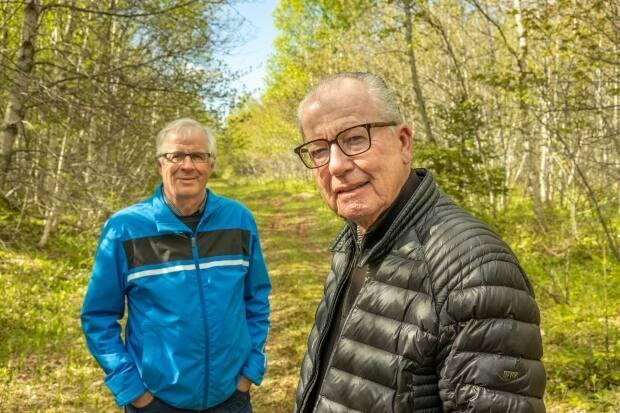 Carl Hansen, left, and Dan MacIsaac purchased the parcel of land 20 years ago and donated it to the Island Nature Trust as a ecological gift.