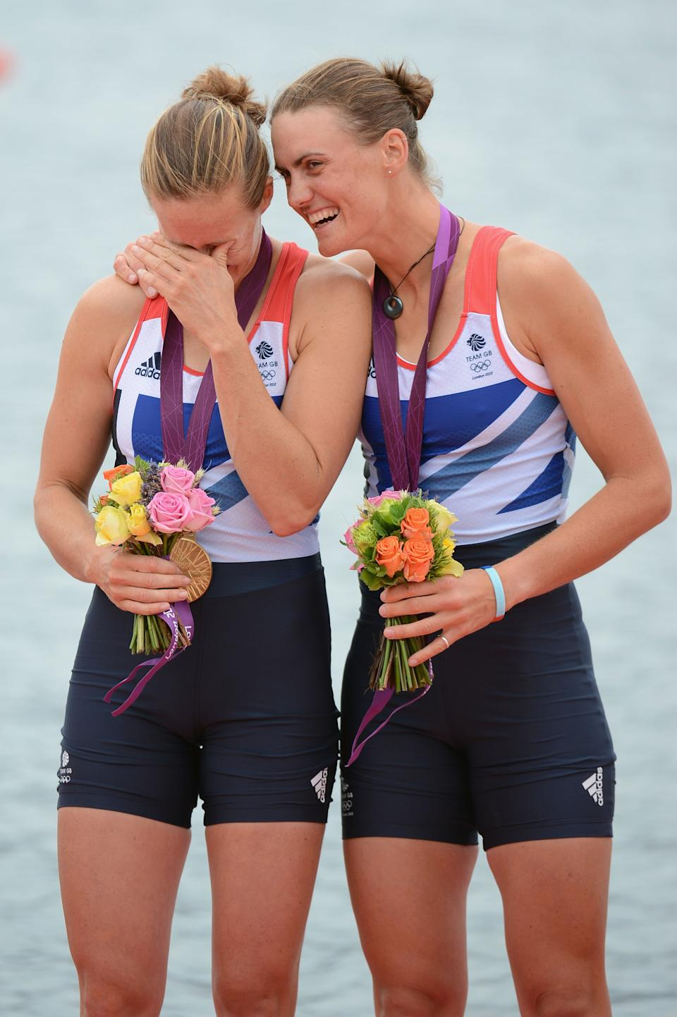 WINDSOR, ENGLAND - AUGUST 01: (L-R) Helen Glover and Heather Stanning of Great Britain celebrate with their gold medals during the medal ceremony after the Women's Pair Final A on Day 5 of the London 2012 Olympic Games at Eton Dorney on August 1, 2012 in Windsor, England. Australia won silver and New Zealand won bronze. (Photo by Harry How/Getty Images)