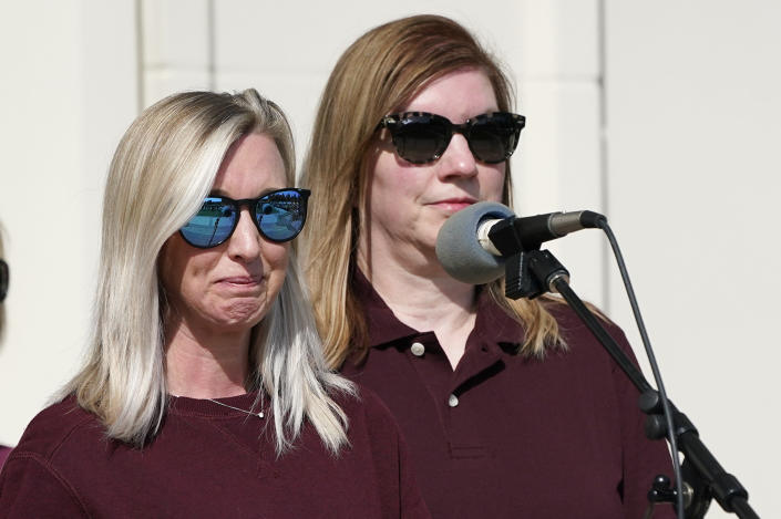 Hollie Skaggs, left, fights back tears as she and Sara Wiles, right, speak during a prayer vigil at the Collierville Town Hall, Friday, Sept. 24, 2021, in Collierville, Tenn. Both Skaggs and Wiles were shopping in a Kroger grocery store Thursday when a gunman attacked people, killing one and injuring several, before he was found dead of an apparent self-inflicted gunshot wound. (AP Photo/Mark Humphrey)