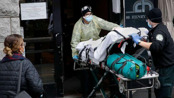 PHOTO: A patient is wheeled into Cobble Hill Health Center by emergency medical workers in the Brooklyn borough of New York, April 17, 2020. (John Minchillo/AP, FILE)