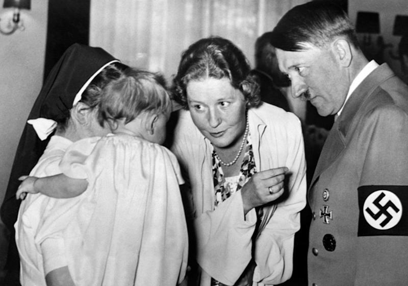 A picture dated 1939 shows German nazi Chancellor and dictator Adolf Hitler (R) with Emmy Goering (C) talking to a baby hold by a nun. AFP PHOTO / FRANCE PRESSE VOIR (Photo credit should read -/AFP/Getty Images)