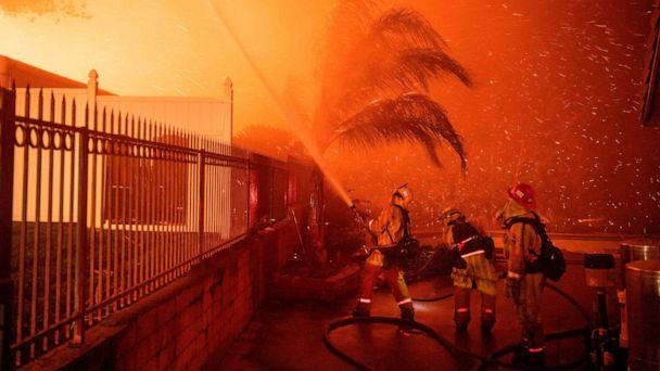 PHOTO:Firefighters battle wind-whipped flames engulfing multiple homes during the Hillside Fire in the North Park neighborhood of San Bernardino, Calif., Oct. 31, 2019. (Josh Edelson/AFP/Getty Images)