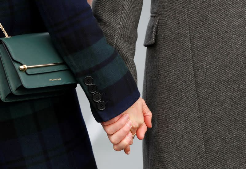 FILE PHOTO: Meghan Markle, and Britain's Prince Harry, meet members of the crowd during a visit to Edinburgh