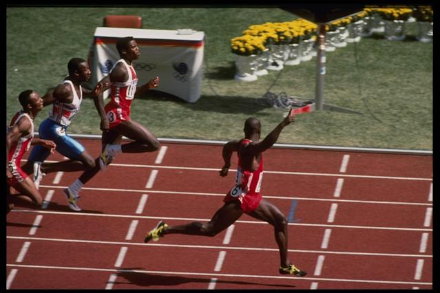 Ben Johnson of Canada celebrates as he crosses the finish line well ahead of Carl Lewis of the USA and Linford Christie of Great Britain to win the mens 100m final during the 1988 Summer Olympic Games in Seoul, South Korea. Johnson won thegold medal with a world record time of 9.79. However, the gold medal was revoked by the IOC on the following day because Johnson's post-race drug test indicated steroid use. Mandatory Credit: Simon Bruty/Allsport (Getty Images)