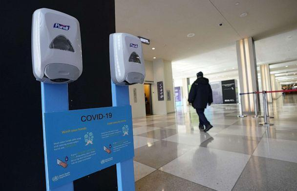 PHOTO: Hand sanitizers hang on the wall with a sign about the novel coronavirus, known officially as COVID-19, at the United Nations headquarters in New York City, U.S., on Feb. 27, 2020. (Timothy A. Clary/AFP via Getty Images)