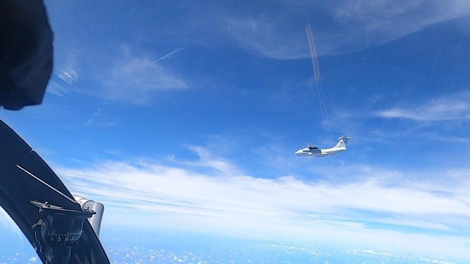 <p>A plane with a Chinese flag on its tail is seen in this handout picture from the Royal Malaysian Air Force</p> (Reuters)