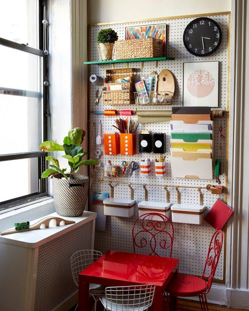 """<p>Use colorful craft supplies as wall decor by hanging a pegboard in your kids' craft room and filling it with shelves, folders, baskets, and buckets.</p><p><strong>See more at </strong><strong><a href=""""https://cupofjo.com/2015/01/brooklyn-apartment-tour/"""" rel=""""nofollow noopener"""" target=""""_blank"""" data-ylk=""""slk:A Cup Of Jo"""" class=""""link rapid-noclick-resp"""">A Cup Of Jo</a>.</strong></p><p><strong><a class=""""link rapid-noclick-resp"""" href=""""https://www.amazon.com/s?k=peg+wall&ref=nb_sb_noss&tag=syn-yahoo-20&ascsubtag=%5Bartid%7C10063.g.36014277%5Bsrc%7Cyahoo-us"""" rel=""""nofollow noopener"""" target=""""_blank"""" data-ylk=""""slk:SHOP PEG WALLS"""">SHOP PEG WALLS</a><br></strong></p>"""