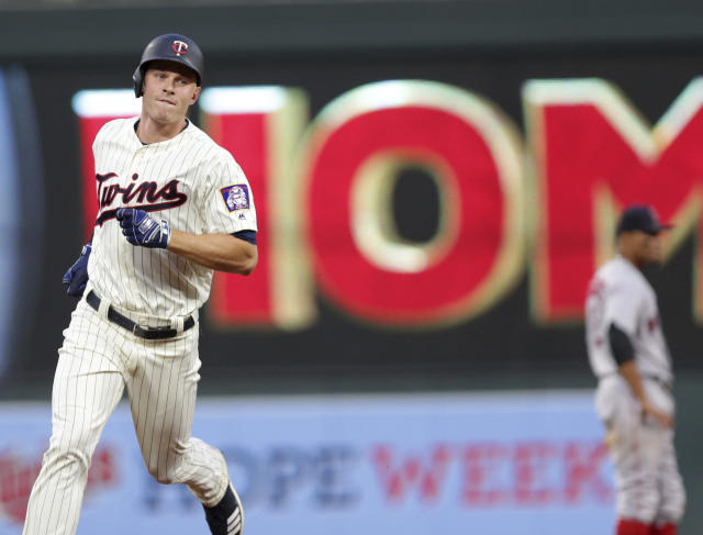 Minnesota Twins' Max Kepler runs the bases after hitting a two-run home run against the Boston Red Sox in the fourth inning of a baseball game Wednesday, June 20, 2018, in Minneapolis. (AP Photo/Andy Clayton-King)