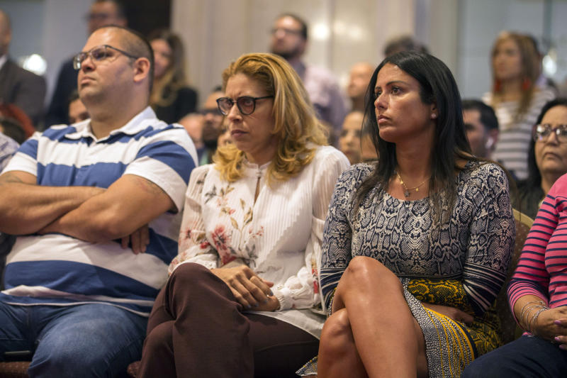 Citizens attend Pedro Pierluisi's confirmation hearing at the House of Representatives, in San Juan, Puerto Rico, Friday, August 2, 2019. As Gov. Ricardo Rossello is expected to leave office in a few hours, the Puerto Rican House of Representatives is expected to vote on Pierluisi's confirmation Friday afternoon. If he is rejected, Justice Secretary Wanda Vazquez automatically becomes governor as the next in the order of succession, even though she has said she would unwillingly accept the job. (AP Photo/Dennis M. Rivera Pichardo)