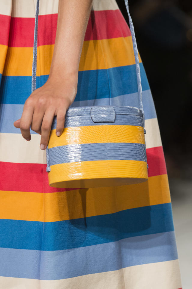 <p><i>Blue-and-yellow-striped bag from the SS18 Carolina Herrera collection. (Photo: ImaxTree) </i></p>
