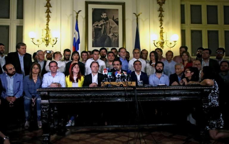 Chilean lawmakers at a press conference after reaching an agreement on holding a referendum to change the constitution, a key demand of protesters during a month of violent unrest