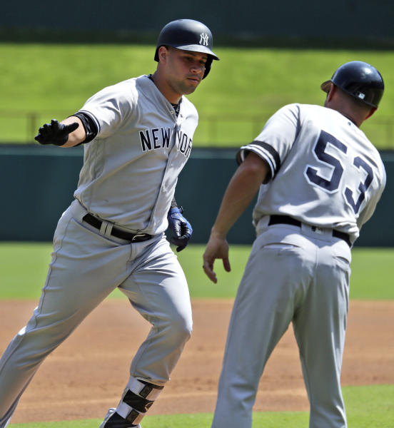 New York Yankees' Gary Sanchez, left, is congratulated by third base coach Joe Espada (53) after his solo home run during the first inning of a baseball game against the Texas Rangers in Arlington, Texas, Sunday, Sept. 10, 2017. (AP Photo/LM Otero)