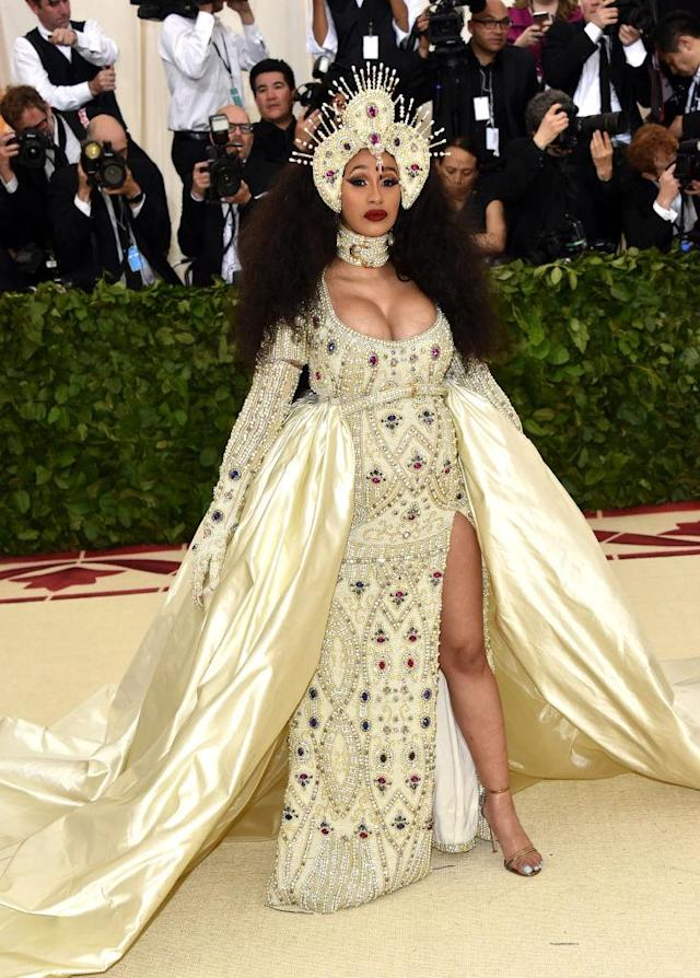 <p>The rapper wanted to channel her Catholic roots in this look by Jeremy Scott. (Photo: Getty Images) </p>