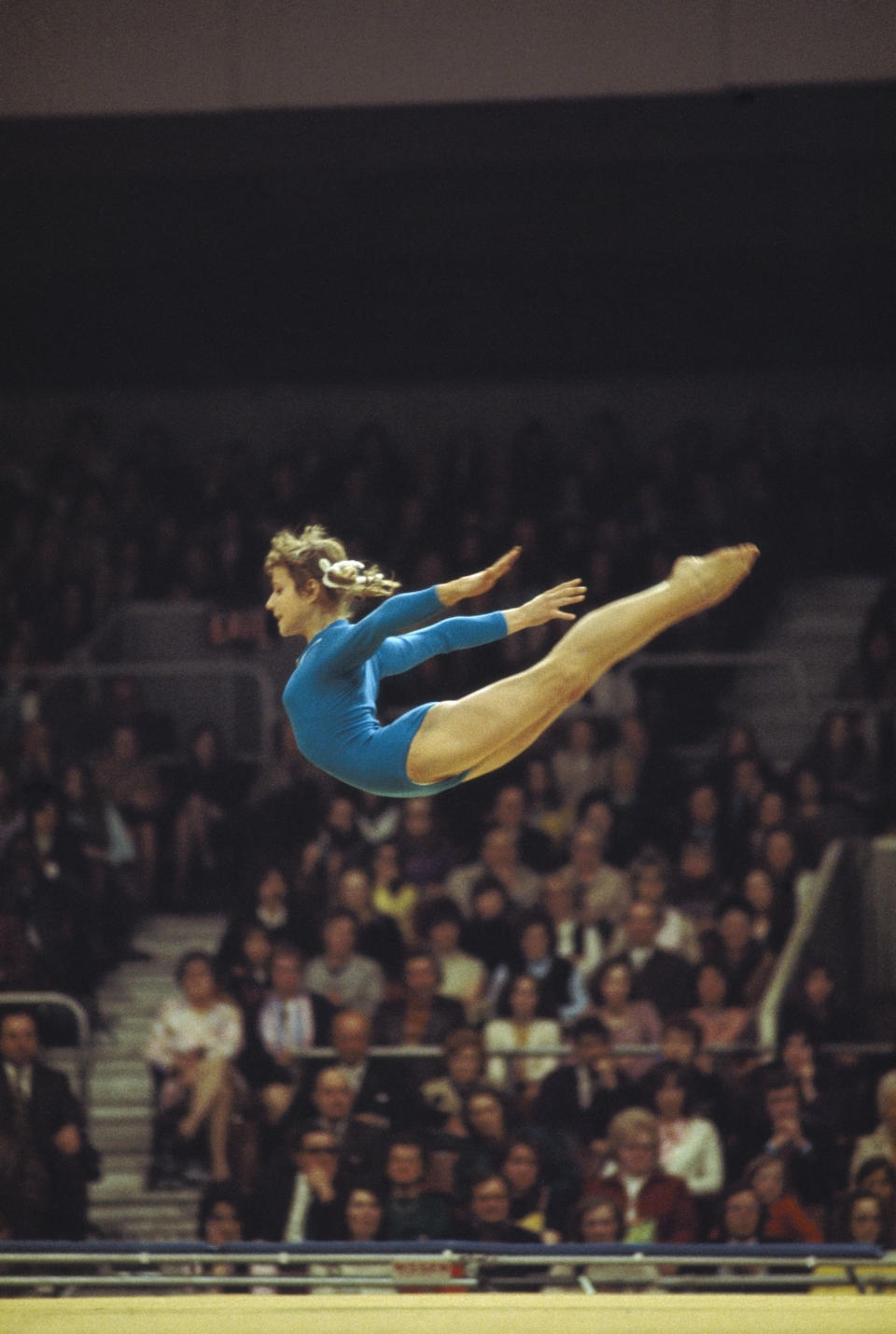 <b>1972 Munich Olympics </b><br> 1972: Olga Korbut of the Soviet Union in action during the gymnastics competition at the 1972 Olympic Games in Munich, Germany. The pretty gymnast won gold on the balance beam, the floor exercises and was also a member of the winning all-round team aswell as a silver medalist on the uneven parallel bars. She captured the hearts of the world with her impish style and brilliant smile. Mandatory Credit: Allsport UK/Allsport