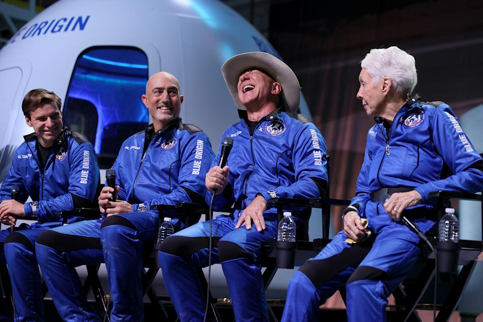 Oliver Daemen, Mark Bezos, Jeff Bezos and Wally Funk hold a press conference after their flight in Van Horn, Texas, Tuesday. (Photo by Joe Raedle/Getty Images)
