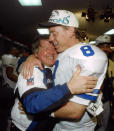 """FILE - In this Sunday, Jan. 30, 1994, file photo, Dallas Cowboys' head coach Jimmy Johnson hugs quarterback Troy Aikman in their locker room after defeating the Buffalo Bills 30-13 in Super Bowl XXVIII at the Georgia Dome in Atlanta. """"Jimmy was a Hall of Fame personnel guy,"""" Aikman said. """"One of his greatest strengths was his ability to evaluate talent and maneuver draft picks — all those things set him up to be a Hall of Fame coach.""""(AP Photo/Charles Krupa, File)"""