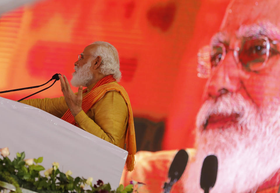 Indian Prime Minister Narendra Modi addresses a gathering during the groundbreaking ceremony of a temple dedicated to the Hindu god Ram, in Ayodhya, India, Wednesday, Aug. 5, 2020. Hindus rejoiced as Modi broke ground on a long-awaited temple of their most revered god, Ram, at the site of a demolished 16th century mosque. (AP Photo/Rajesh Kumar Singh)