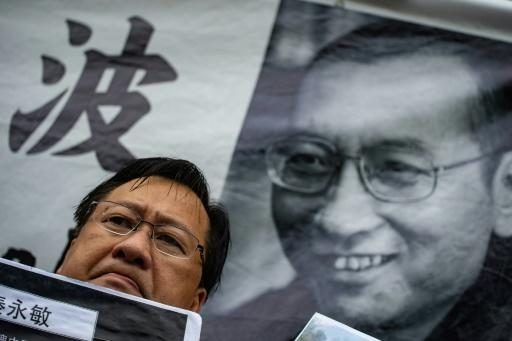 In Hong Kong on Friday, activists attached a picture of Liu to the wall outside the Chinese government's office in the city