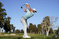 Dustin Johnson tees off on the 17th hole during the second round of the Genesis Invitational golf tournament at Riviera Country Club, Friday, Feb. 19, 2021, in the Pacific Palisades area of Los Angeles. (AP Photo/Ryan Kang)