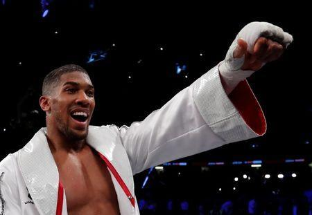 FILE PHOTO: Boxing - Anthony Joshua vs Joseph Parker - World Heavyweight Title Unification Fight - Principality Stadium, Cardiff, Britain - March 31, 2018 Anthony Joshua celebrates after winning the fight Action Images via Reuters/Andrew Couldridge