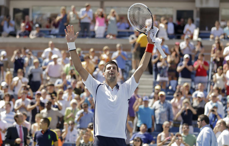 Novak Djokovic of Serbia reacts after beating Spain's David Ferrer during a semifinal match at the 2012 US Open tennis tournament,  Sunday, Sept. 9, 2012, in New York. (AP Photo/Mike Groll)