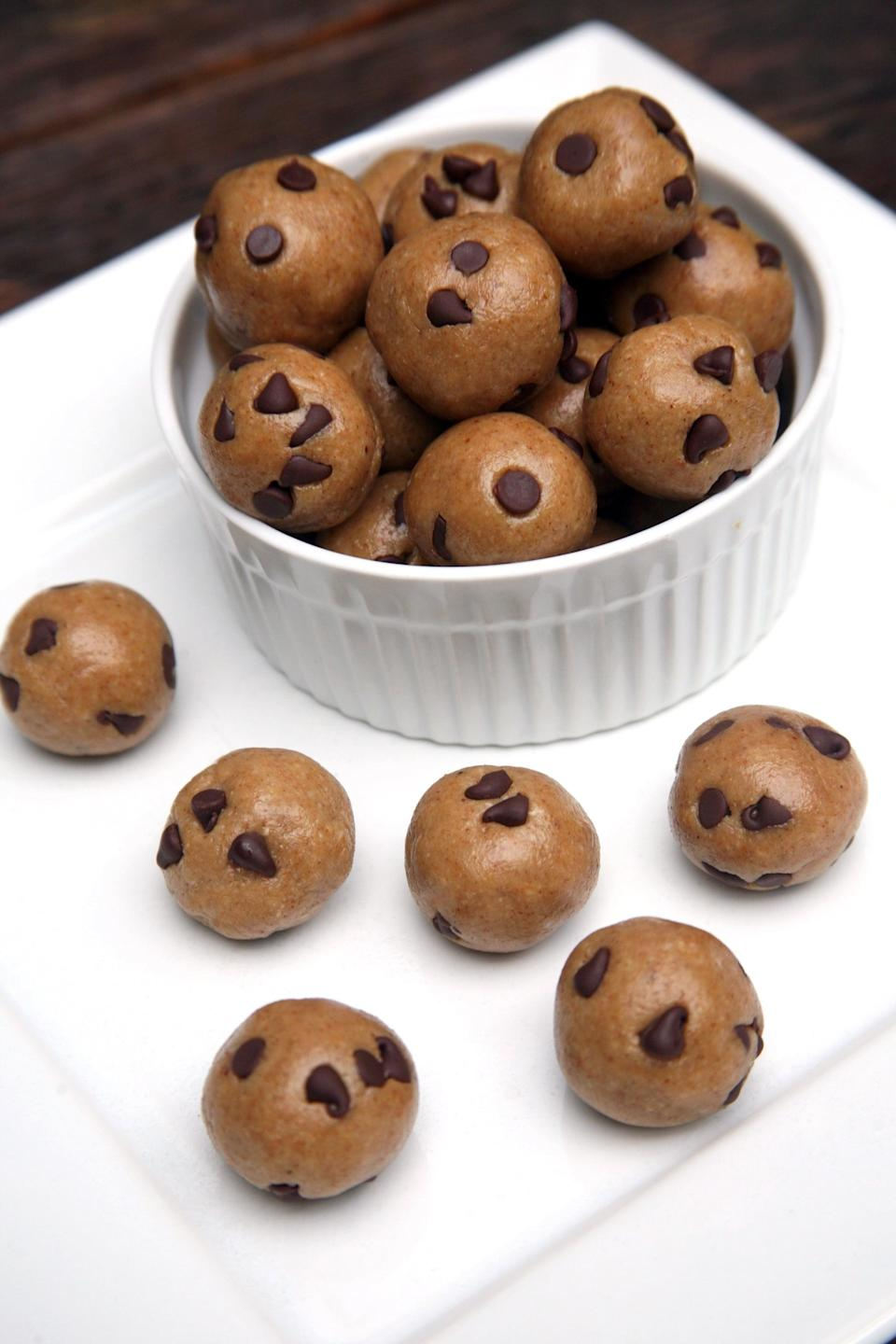 """<p>They taste just like cookie dough!</p> <p><strong>Get the recipe:</strong> <a href=""""https://www.popsugar.com/fitness/Chocolate-Chip-Cookie-Dough-Balls-41871192"""" class=""""link rapid-noclick-resp"""" rel=""""nofollow noopener"""" target=""""_blank"""" data-ylk=""""slk:vegan chocolate chip cookie dough balls"""">vegan chocolate chip cookie dough balls</a></p>"""