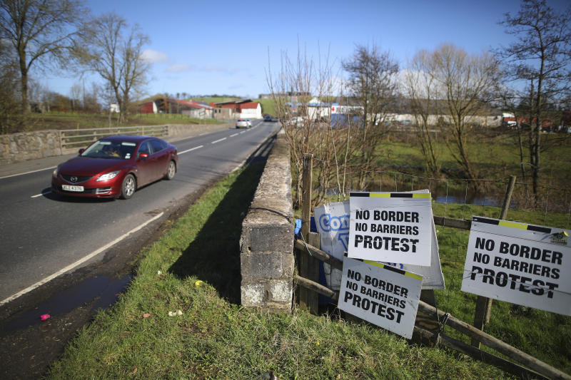 FILE - In this March 12, 2019, file photo, a motorist crosses the Irish border in Middletown, Northern Ireland. With Brexit due on Oct. 31, 2019 and a costly no-deal a possible outcome, experts still do not know, or are reluctant to say, exactly what checks are likely at the Irish border. Nevertheless, British Prime Minister Boris Johnson remains convinced that a Brexit deal can be sealed with the EU in a few weeks. (AP Photo/Peter Morrison, File)