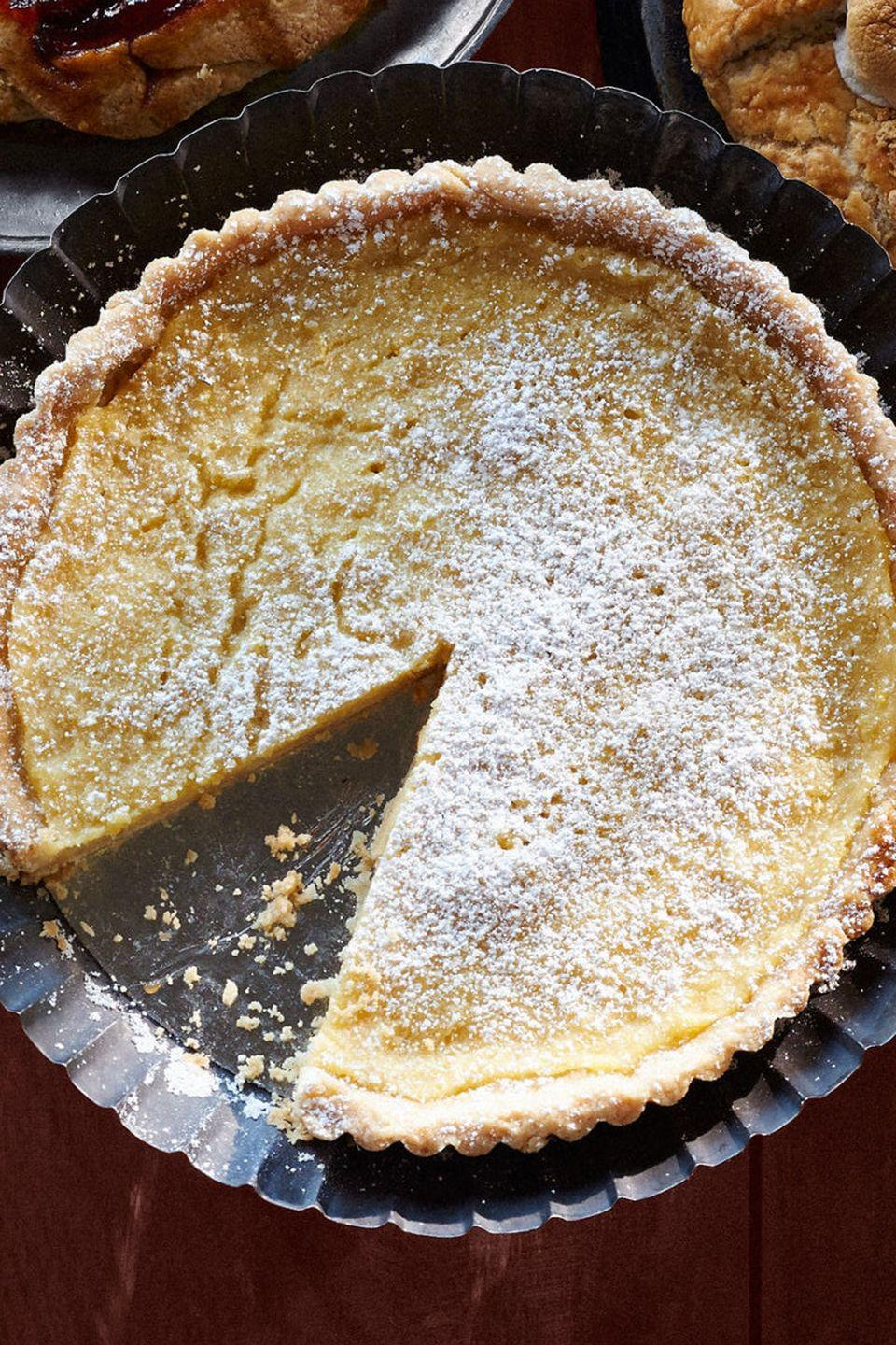 """<p>This lemon tart is an excellent alternative to typical Thanksgiving desserts.</p><p><strong><a href=""""https://www.countryliving.com/food-drinks/recipes/a36547/lemon-buttermilk-tart/"""" rel=""""nofollow noopener"""" target=""""_blank"""" data-ylk=""""slk:Get the recipe"""" class=""""link rapid-noclick-resp"""">Get the recipe</a>.</strong></p>"""