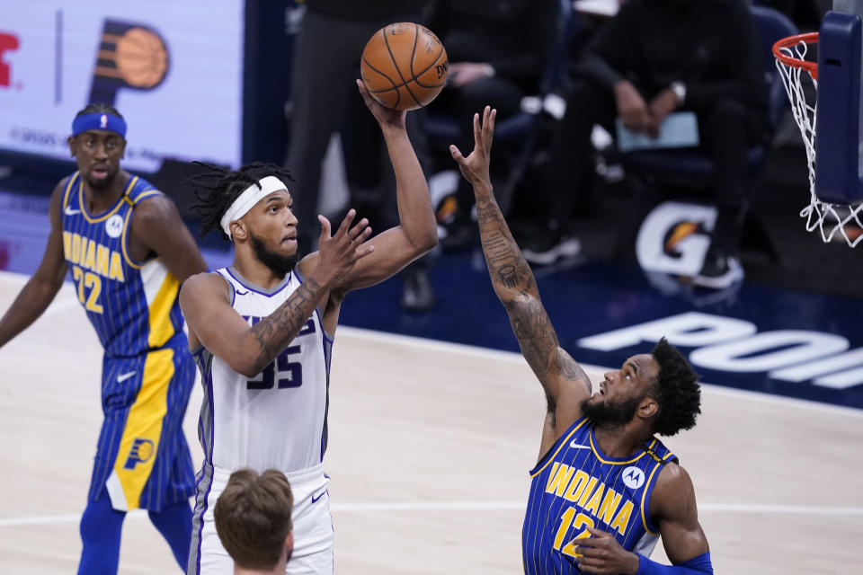 Sacramento Kings' Marvin Bagley III (35) shoots over Indiana Pacers' Oshae Brissett (12) during the first half of an NBA basketball game Wednesday, May 5, 2021, in Indianapolis. (AP Photo/Darron Cummings)